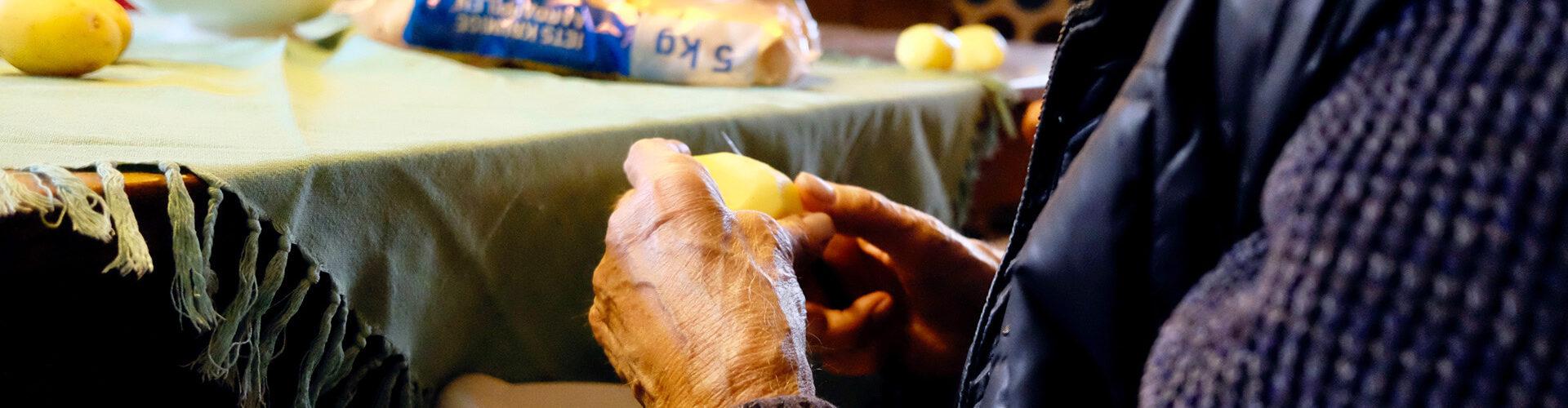 hands pealing potatoes
